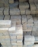 Stacked Landscape Bricks with Wire Mesh. Tan landscape brick in stacks covered with wire mesh Royalty Free Stock Images
