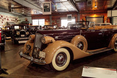 Tan and maroon 1937 Packard V12. El Segundo, CA, USA - September 26, 2016: Tan and maroon 1937 Packard V12 displayed at the Automobile Driving Museum in El Royalty Free Stock Photography