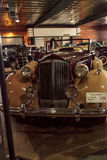 Tan and maroon 1937 Packard V12. El Segundo, CA, USA - September 26, 2016: Tan and maroon 1937 Packard V12 displayed at the Automobile Driving Museum in El Royalty Free Stock Photo