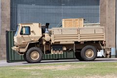 Tan Military Utility and Troop Carrier Diesel Vehicle. Tan Military Utility Multipurpose Troop Carrier Vehicle Royalty Free Stock Photo