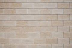 Tan wall tiles background texture. Tan rectangular wall tiles background texture royalty free stock image