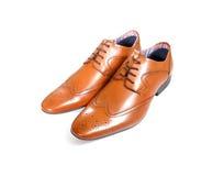 Tan schoenen over wit Stock Afbeelding