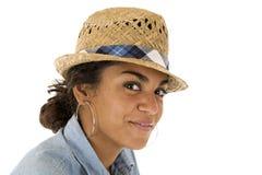 Tan teenage girl wearing a straw woven fedora hat Royalty Free Stock Image