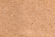 Tan Textured Paper. A tan sheet of textured paper, suitable as a background texture Stock Photography