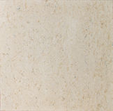 Tan textured travertine. Could be used for background Royalty Free Stock Images