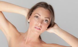 Tan and Toned. A portrait of a beautiful young woman with tan skin royalty free stock photos