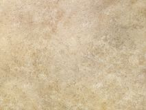 Tan travertine marble surface texture. Beige tan travertine marble background surface texture Royalty Free Stock Image