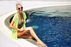 Tan woman applying sun protection lotion Stock Images