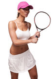 Tan woman in white sportswear and tennis racquet. Tan woman in white sportswear and and pink cap holding tennis racquet Royalty Free Stock Image
