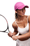 Tan woman in white sportswear and tennis racquet. Tan woman in white sportswear and and pink cap holding tennis racquet Stock Images