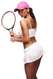 Tan woman in white sportswear and tennis racquet Stock Photo