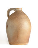 Tan and Yellow Clay Jug. Oval shaped tan and yellow clay jug with handle, white background, angular view stock image