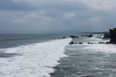 Tanah Lot, an Indonesian island. The temple; significantly influenced by Hinduism Royalty Free Stock Photos