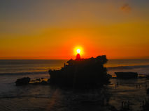 Tanah Lot and sea waves in golden sunset, Bali Royalty Free Stock Images