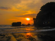 Tanah Lot and sea waves in golden sunset, Bali Royalty Free Stock Photography