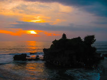 Tanah Lot and sea waves in golden sunset, Bali Royalty Free Stock Image