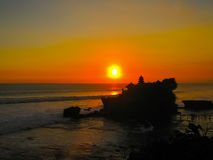 Tanah Lot and sea waves in golden sunset, Bali Royalty Free Stock Photo