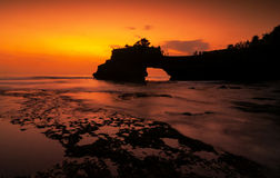 Tanah Lot temple in golden sunset Stock Photo
