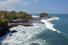 Tanah Lot Temple on Rock at High Tide with Tourists Royalty Free Stock Photo
