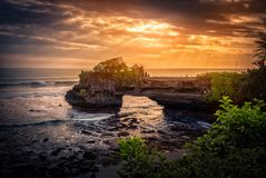 Tanah Lot Temple on sea at sunset in Bali Island Stock Photos