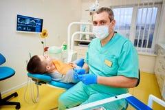 Tand- kontor, tand- behandling, vård- förhindrande royaltyfri foto