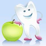 Tand och äpple Arkivbild