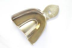Tand- rostfritt stålmagasin Arkivbild