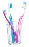 tandborstar för exponeringsglas tre Arkivbild