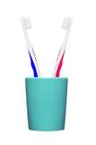 Tandborstar i exponeringsglas som isoleras på vit Royaltyfri Foto