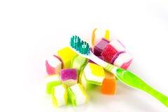 Tandborste på godisbakgrund Arkivbild