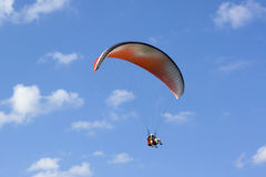 Tandem. Paragliding tandem in the sky stock photos
