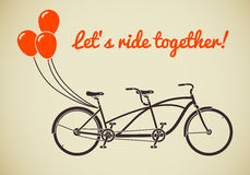 Tandem bicycle with balloons Stock Image