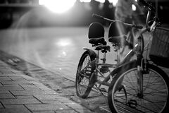 Tandem Bicycle on Sidewalk in Greyscale Photography Stock Photography