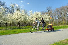 Tandem bicycle two. A young couple on holiday on a country road Stock Images