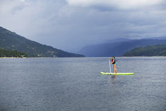 girl paddle boarding Stock Photography