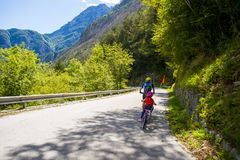 Father and daughter going in bicycle. Tandem of father and daughter, family cycling in Alpe Adria itinerary - Friuli-Venezia Giulia, Italy Royalty Free Stock Images