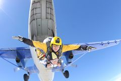 Tandem jump. Skydiving in the blue sky. stock photos