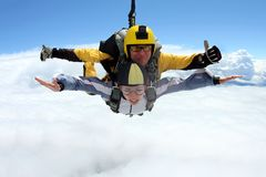 Tandem jump. Skydiving in the blue sky. stock photography