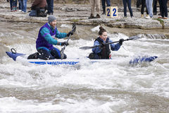 Tandem Kayak-River Race, Port Hope, March 31/2012. Participants paddle an inflatable tandem kayak through the Ganaraska River rapids on March 31, 2012 in Port Stock Photos