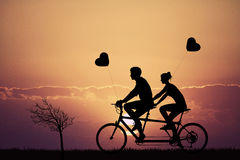 Tandem love at sunset Stock Images