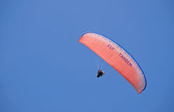 Tandem paraglider. Bright parachute in clear blue sky Stock Images