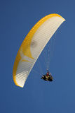 Tandem Paraglider against a blue sky Royalty Free Stock Images
