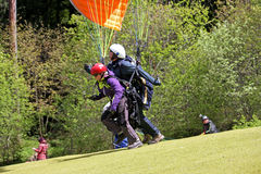 Tandem Paraglider launching Stock Photo