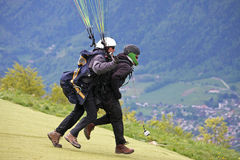Tandem Paraglider running to Launch Stock Photos
