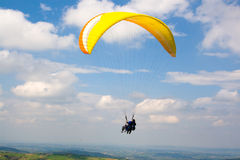 Tandem Paragliding. Two paragliders doing tandem flight Royalty Free Stock Image