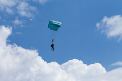 Tandem paragliding in the blue sky, flying Stock Photos