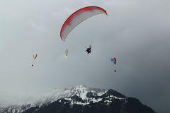 Tandem paragliding flights over the Swiss Alps Royalty Free Stock Image