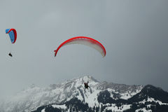 Tandem paragliding flights over the Swiss Alps Royalty Free Stock Images