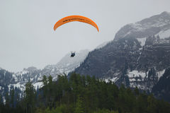 Tandem paragliding flights over the Swiss Alps Royalty Free Stock Photo