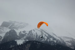 Tandem paragliding flights over the Swiss Alps Stock Images